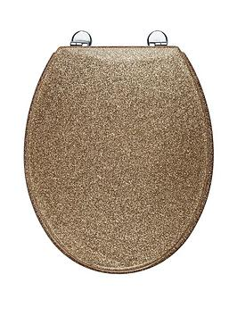 gold plated toilet seat.  Croydex Gold Glitter Toilet Seat very co uk