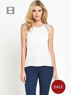 definitions-crochet-sleeve-embellished-blouse