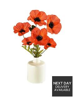 3-poppies-in-ceramic-vase