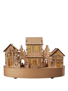 lit-wooden-christmas-houses-with-movement