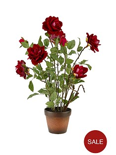 artificial-red-roses-in-terracotta-pot