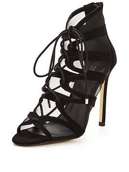 http://media.very.co.uk/i/very/CQAYX_SQ1_0000000004_BLACK_SLf/v-by-very-saffron-mesh-strappynbsptie-sandal.jpg?$266x354_standard$&$roundel_very$&p1_img=sale_roundel_further_red