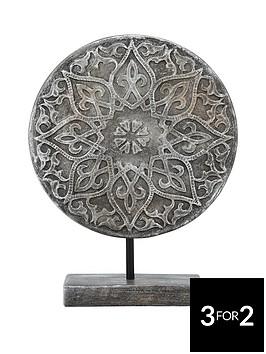 ornate-disc-sculpture