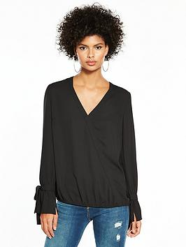 d1a94cbb06cd61 Another black option at hush. This style is one of their most popular -  universally flattering and perfect worn over their leather leggings or  skinny jeans.