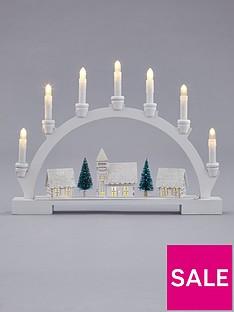 lit-wood-candle-bridge-scene-christmas-decoration