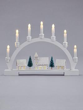 lit-wood-candle-bridge-scene-christmas-decoration