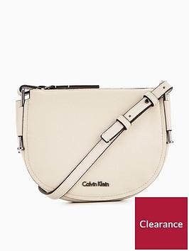 calvin-klein-arch-small-saddle-bag-cement