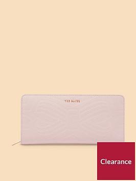 ted-baker-mellvna-embossed-bow-zip-matinee-purse-light-pink