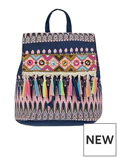 monsoon-zig-zag-tassle-backpack