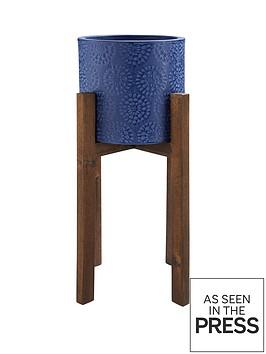 deep-blue-planter-on-wooden-legs
