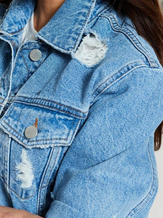 bfb67371ef ... Michelle Keegan Ripped Detail Denim Jacket - Blue Wash / Previous. 2  people are looking at this right now.