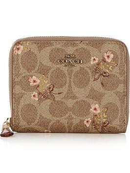 coach-prairie-coated-canvas-zip-around-purse-tan