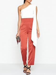 outline-one-shoulder-draped-jumpsuit-rust