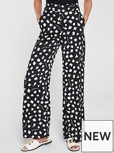 90704d2a6993d River Island River Island X Caroline Flack Printed Trousers - Beige