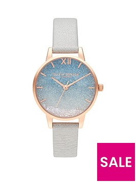 olivia-burton-olivia-burton-under-the-sea-blue-and-rose-gold-detail-wishing-wave-glitter-dial-white-leather-strap-ladies-watch