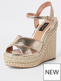 47f27642 River Island River Island Wide Fit Stud Cross Strap Wedge - Gold