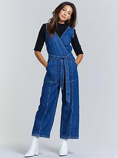 michelle-keegan-sleeveless-denim-jumpsuit-mid-wash