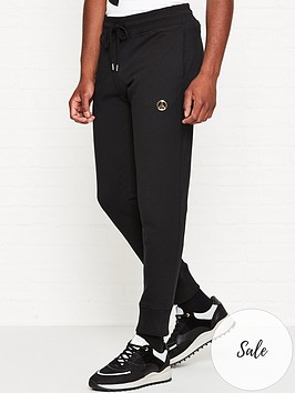 love-moschino-gold-peace-sign-logo-slim-fit-joggers-black