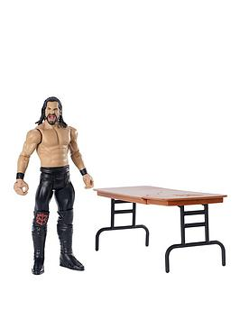 wwe-wrekkinrsquo-seth-rollins-with-table