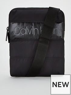 calvin-klein-padded-flat-crossover-bag-black