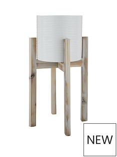 white-ribbed-pot-on-wooden-legs
