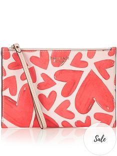 kate-spade-new-york-spencer-heart-print-wristlet-pink