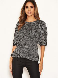 ax-paris-polka-dot-flared-top-black
