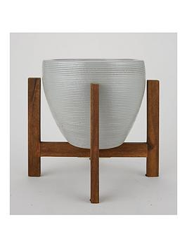 grey-ceramic-planter-on-low-wooden-stand