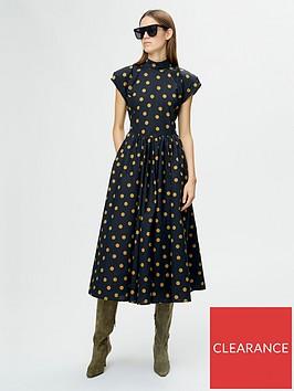 gestuz-cassia-polka-dot-open-back-midi-dress-black