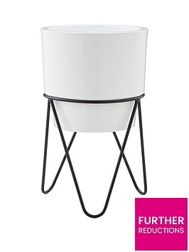white-planter-with-black-metal-stand