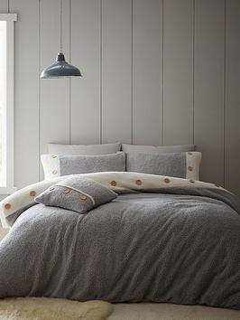 Product photograph showing Catherine Lansfield So Soft Buttoned Sherpa Duvet Cover Set