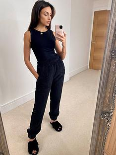 michelle-keegan-racer-neck-ribbed-vest-black