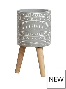 ornate-grey-planter-with-wooden-legs
