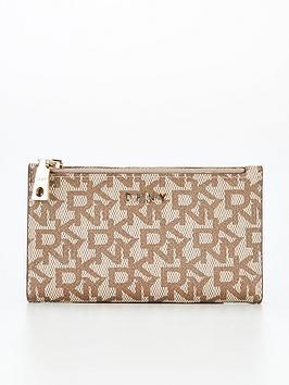 dkny-bryant-coated-logo-bifold-purse-beige