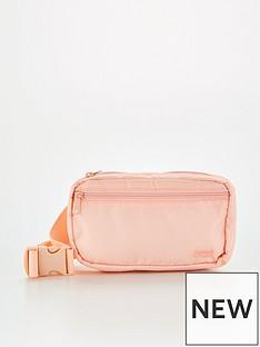 levis-medium-embroidered-banana-sling-bag-light-pink