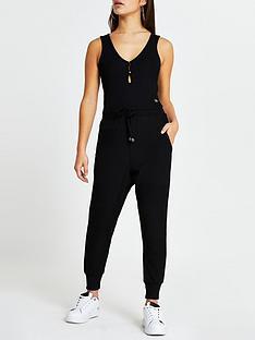 ri-petite-rib-lounge-jumpsuit-black